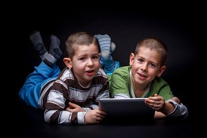 Children using electronic tablet