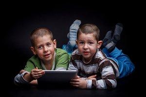 Little boys using digital