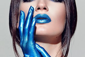 Hands painted in blue paint.