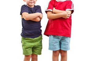 Two boys with arms crossed