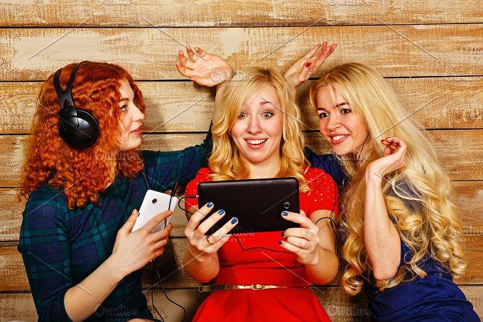 Sisters make selfie. Laughter. Fun. - People