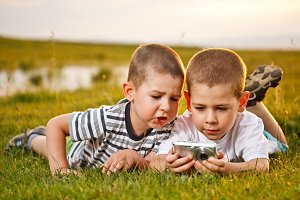 Two brother lying on meadow