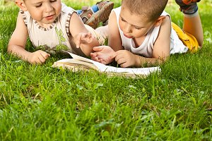 boys reads a book