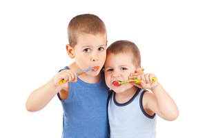 boys brushing his teeth
