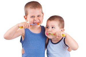 boys brushing his teeth