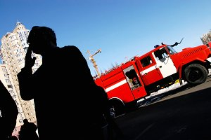 Man smoking in front of fire truck