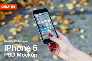 iPhone 6 in hand PSD Mockup