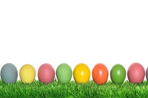 Easter eggs in green grass banner