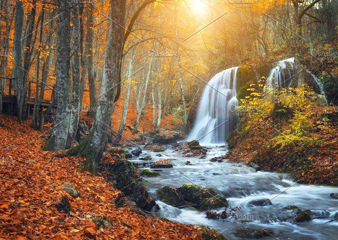 Waterfall at mountain river. Sunset - Nature