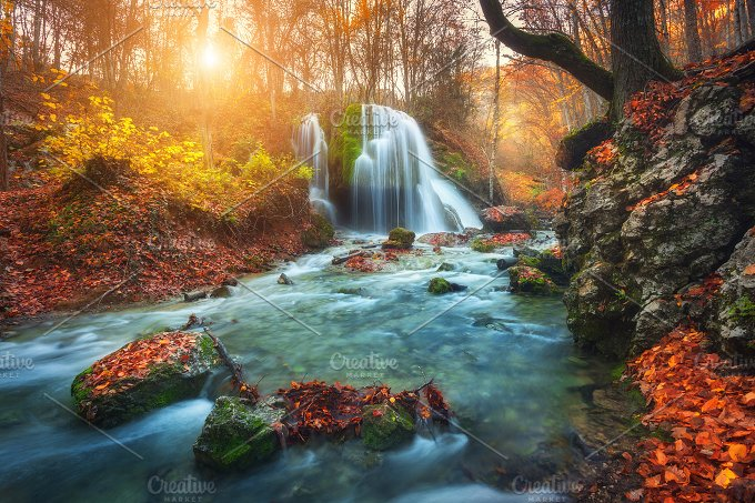 Waterfall at mountain river. Sunset - Nature