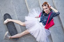 Ballerina hipster sitting on stairs.