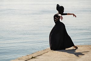 Ballerina in black dress dancing.