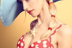 Sexy PinUp woman, red dots swimsuit