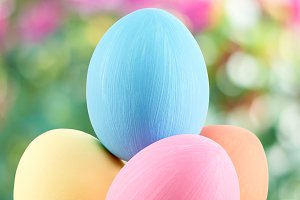 Easter painted eggs in straw nest