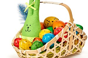 Easter rabbit,painted eggs in basket