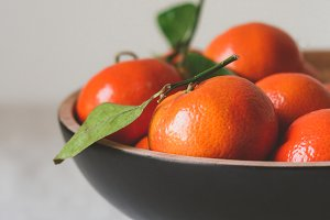 Clementines in black bowl