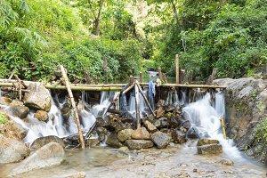 Weir slowing water flow