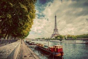Eiffel Tower over Seine River.