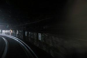 Fast subway train under blue