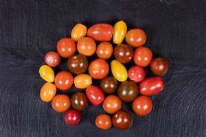 Colorful tomatoes on slate stone