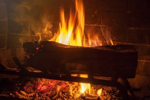 Burning Log in a Fireplace (Photo)