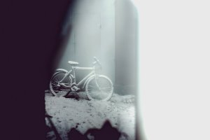 Bicycle covered in snow. Artwork