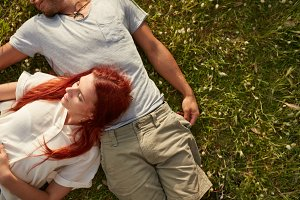 Young couple relaxing on the grass.