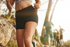 Female trail runner training