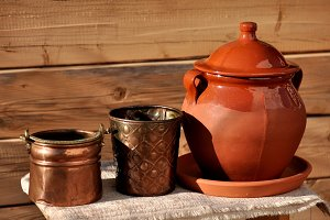 copper cauldrons and clay vessel