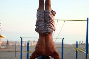 Handstand in beach