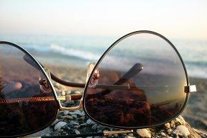 Sea and beach in the sun glasses