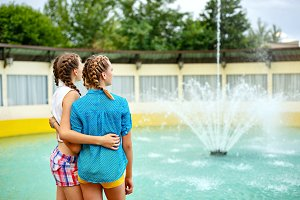 Friendly hug at the fountain.
