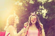 Best girlfriends lollipops. Sunset.