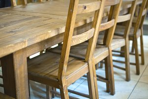Wooden chairs at the table