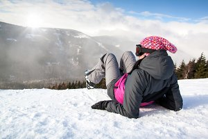 Girl skier lying on snow
