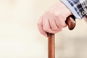 Hand with cane closeup