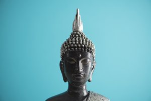 Buddha figure with blue background