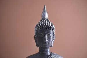 Buddha with brown background