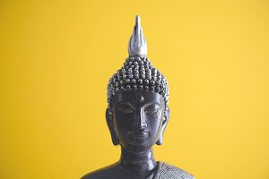 Buddha with yellow background