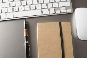 Notebook, pen, keyboard and mouse