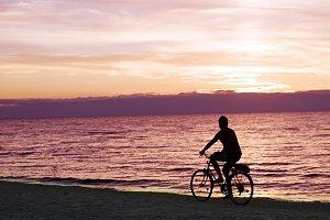Bicyclist on the beach