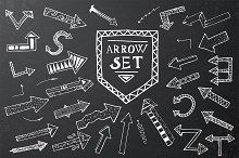 Hand drawn arrow icons set on black