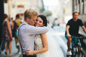 Groom hugs bride