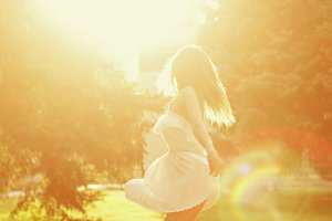 Boho Girl dancing barefoot.