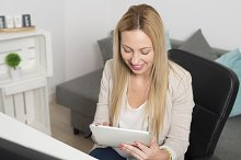 Attractive woman with a tablet