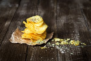 Pile of crispy chips on baking paper