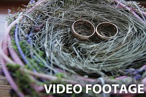 Wedding rings in a beautiful basket.