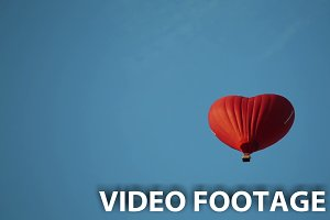 aerostat heart in the blue sky