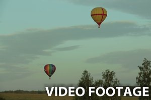 hot air balloons flying over field