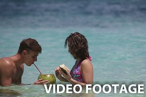 couple on the beach with coconut